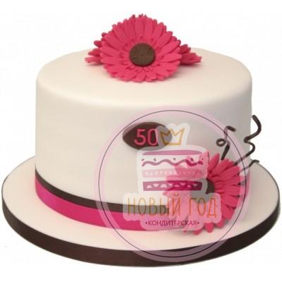 Торт в виде шляпы с герберами на 50 лет